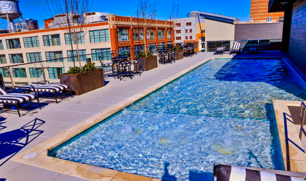 Amenities at West Village include a rooftop pool, kitchen and lounge area atop the four-story clubhouse. [Photo by Chris Landsberger, The Oklahoman]